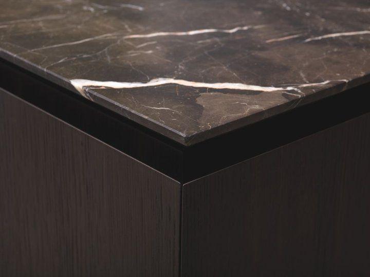 Exquisite dark marble kitchen top by Minotti.