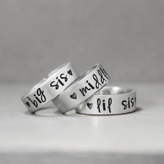 These stamped sister rings make the perfect gift for big sisters, middle sisters and little sisters, or even your daughters for a special gift. The listing includes THREE rings.  ♥ 14 gauge tumbled and polished aluminum ♥ 1/4 wide ♥ Available in Small 4-6.25, Medium 6.5-9, Large 9.25-11.75, XLarge 12-14.  While these sisters rings are adjustable, please make sure to fit the best size for you so we can ensure they fit better. Please make sure to send the ring sizes in your check out notes as…