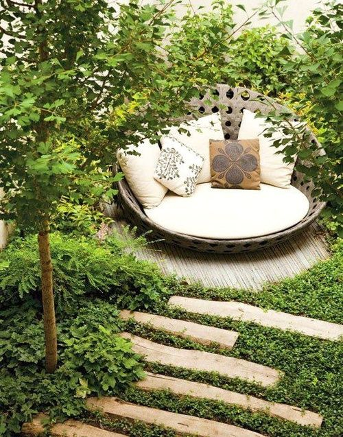 staggered stepping stones to a secret seating area in a lush garden