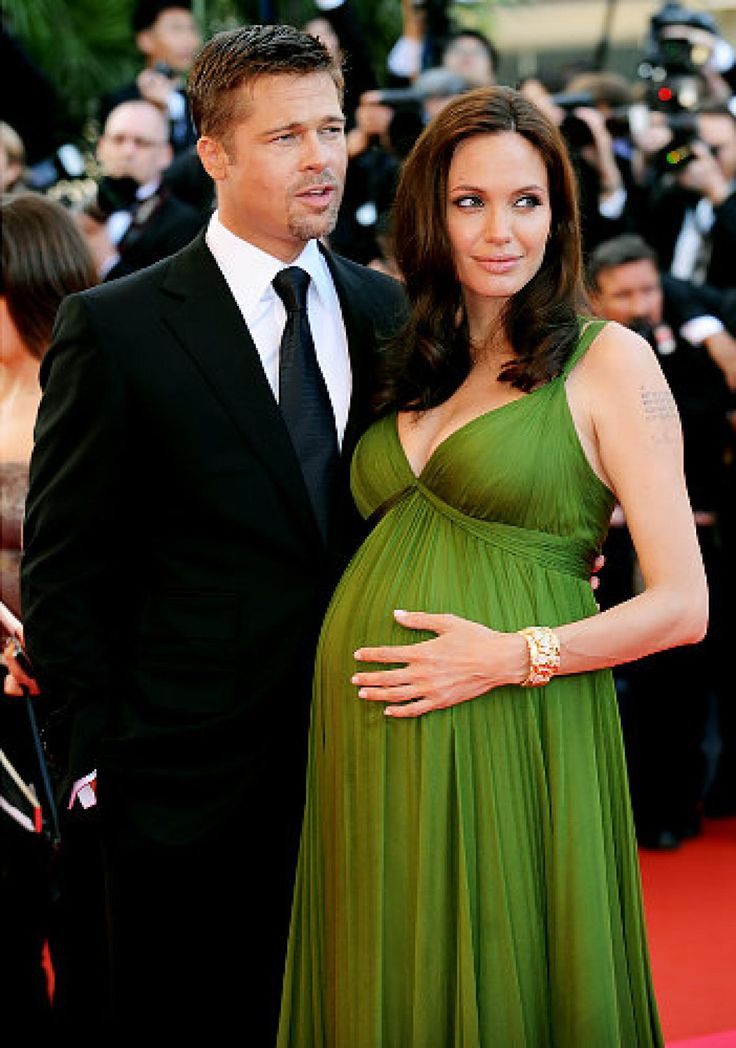 A very pregnant Angelina Jolie and Brad Pitt on the red carpet at the Cannes Film Festival in May. It was her 'Kung-Fu Panda' co-star, Jack Black, who let it slip that Jolie was carrying a double bundle of joy.
