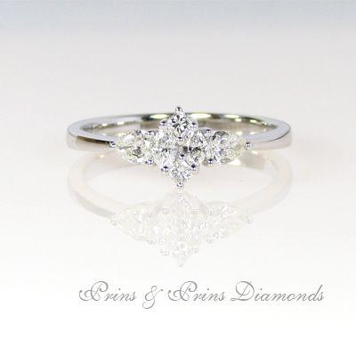 18k white gold ring with 0.52ct HI VS SI round brilliant cut diamond micro set in an illusion setting   1R07031