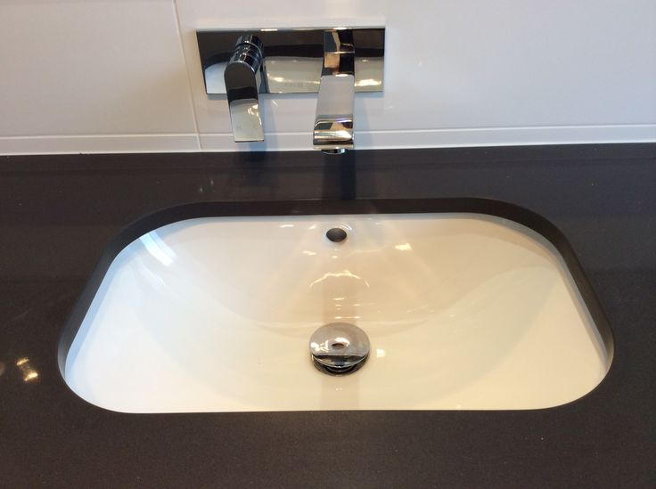 New plumbing for the under-mounted basin with wall mounted mixer and faucet above the vanity in this bathroom renovation. www.connectedplumbgas.com.au