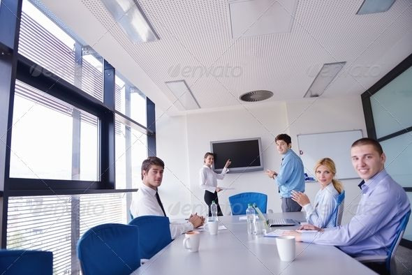 business people in a meeting at office ...  adult, background, briefing, business, businessman, caucasian, communication, computer, conference, corporate, discussion, document, education, executive, female, girl, graphs, group, happy, interior, job, laptop, looking, male, man, manager, meeting, men, modern, office, people, person, portrait, professional, seminar, sitting, smiling, success, suit, table, team, teamwork, together, training, white, woman, women, work, worker, young