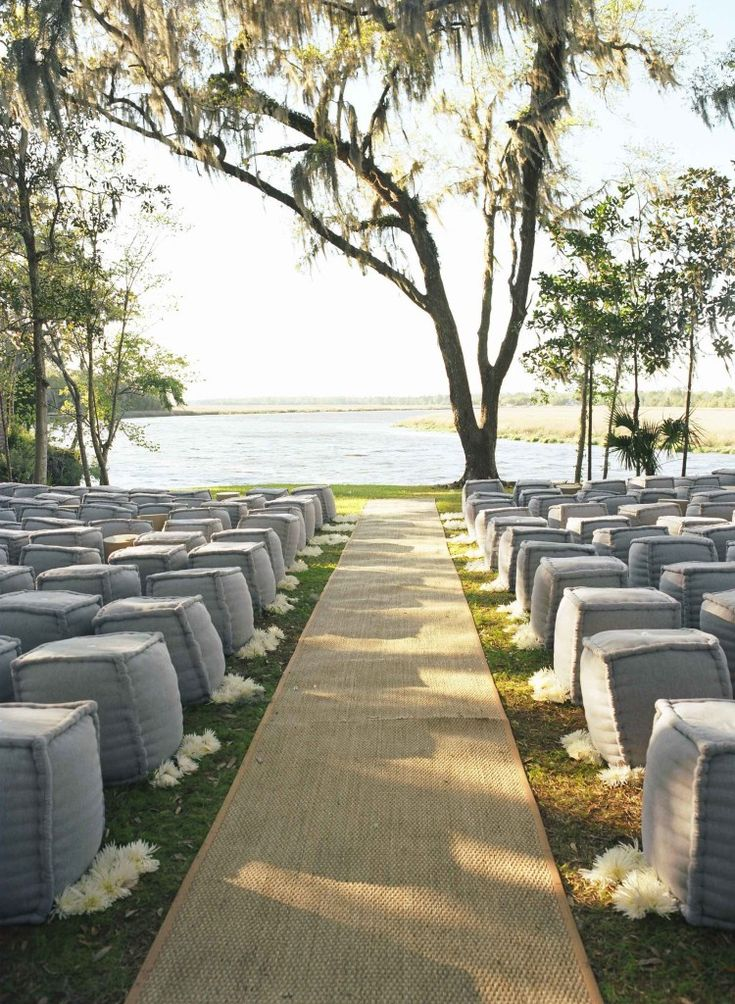 Outdoor wedding ceremony with ottoman seating by Tara Guerard Soiree. photo by Liz Banfield