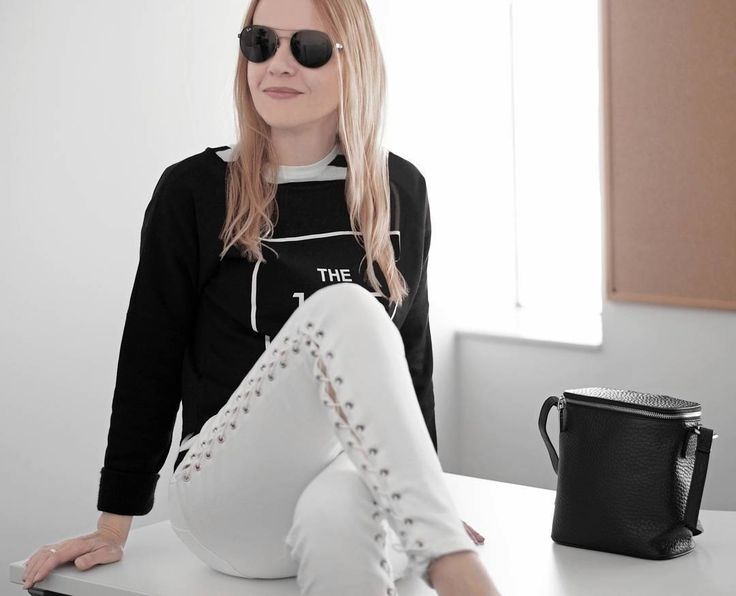 """169 Likes, 10 Comments - Gabriella Buzas (@epicstreetstyle) on Instagram: """"WHITE LACE-UP JEANS FROM SUMMER TO WINTER 🌞🔗💨 on epicstreetstyle.com . ."""" minimal chic outfit ootd wiw what I wear outfitinspo black and white lace-up white jeans topshop style nakedvice bag @topshop @nakedvice @muji @rayban_official"""