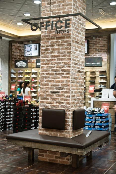 Office Shoes hanging sign around brick column