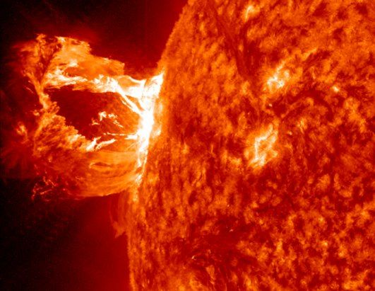 A beautiful prominence seen shooting from the face of the sun by NASA's Solar Dynamics Observatory. The flare is composed of hot, electrically-charged gases. This particular one was not coming in the direction of Earth, so satellites were safe and there were not large new auroras near the poles. (NASA/GSFC/SDO)