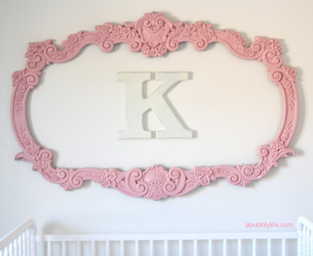 framed monogram above the bed