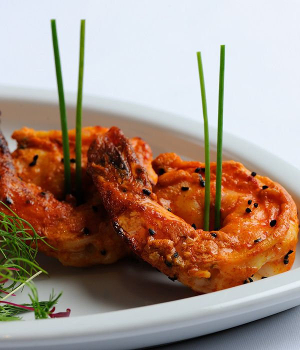 Grilled jumbo tiger prawns marinated with yoghurt, ginger, paprika, ground spices and toasted nigella seeds make for a delicious, fresh and interesting combination in this prawn starter from Alfred Prasad.