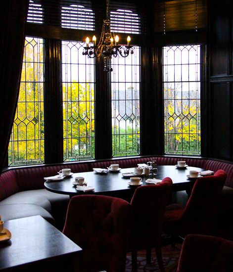 A gorgeous seat in the stained glass bay window at the Fahrenheit Grill, Clontarf Castle Hotel, Dublin. Image © Skye Gilkeson.  IRELAND: Clontarf Castle Hotel, Dublin - The Fit Traveller http://www.thefittraveller.com.au/stay/3800/ #clontarfcastle #thefittraveller #hotelinteriors #luxurytravel