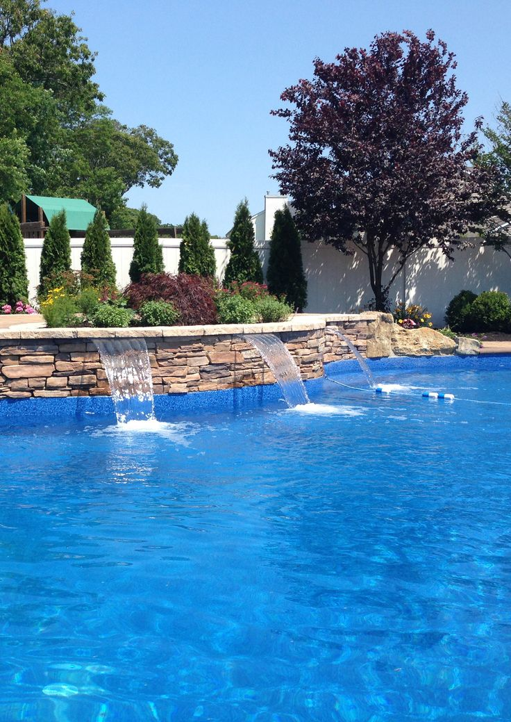 sheer descent waterfall from zodiacpoolusa that we integrated into a freeform pool design in smithtown