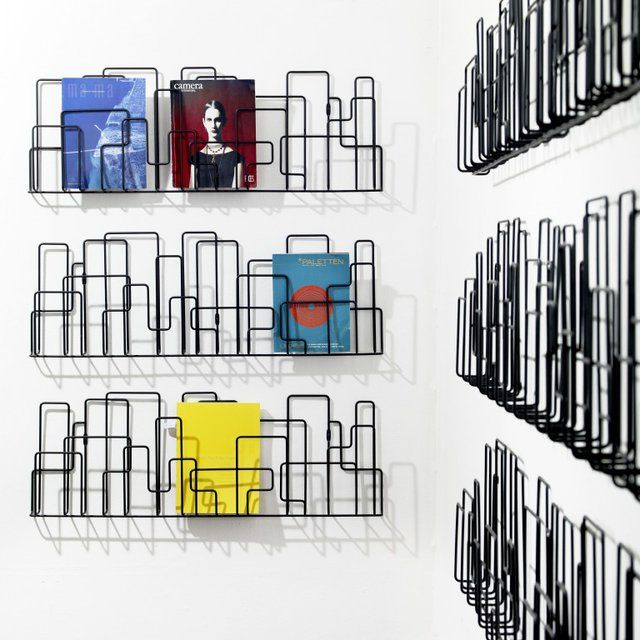 City Sunday Magazine Rack by Minus Tio  City Sunday is a wall-mounted magazine rack that takes its inspiration from real and utopian city structures.
