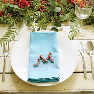 Decorate with winter berries | Have a seat | Love this idea, great details for the table. What a great favor.