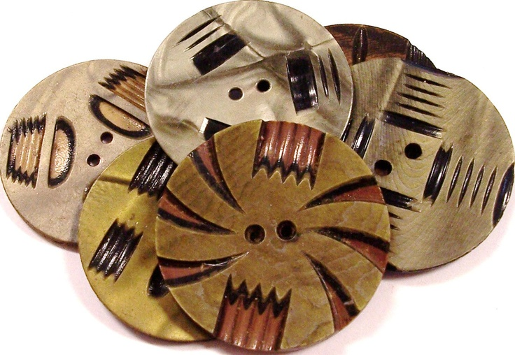 Gorgeous wafer thin celluloid buttons http://www.etsy.com/listing/92924530/vintage-buttons-celluloid-deco-carved