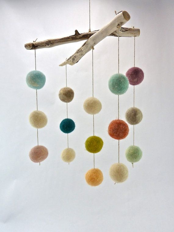 Baby Mobile, Colored Wool Ball Mobile    Looking for a more minimalist piece to add to your babys nursery? This mobile offers simple and sweet pops