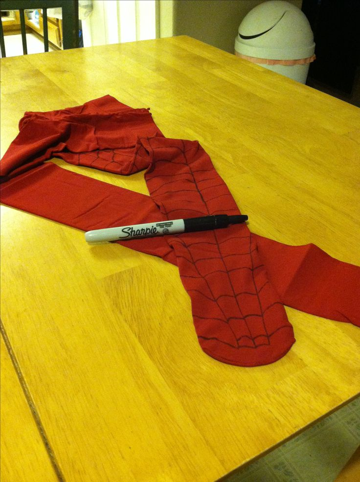 Making part of my Spiderman costume DIY.. Red tights and a sharpie. :-)