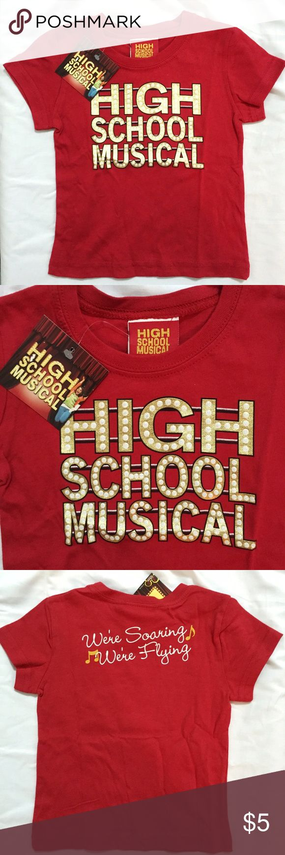 """Disney's High School Musical Marquee Red T-Shirt Brand new with tags, available in Girls size 4T & 5T. Size 5T is missing tags but is new and never worn. This Disney's High School Musical Marquee Red and Gold T-Shirt is perfect for any High School Musical fan. Has the famous lyric """"We're Soaring, We're Flying"""" on the back. Add on to a bundle to save on shipping. Disney Shirts & Tops Tees - Short Sleeve"""