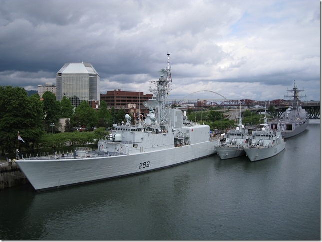 Navy & Coast Guard ships line the waterfront during the Rose Festival, Portland, OR
