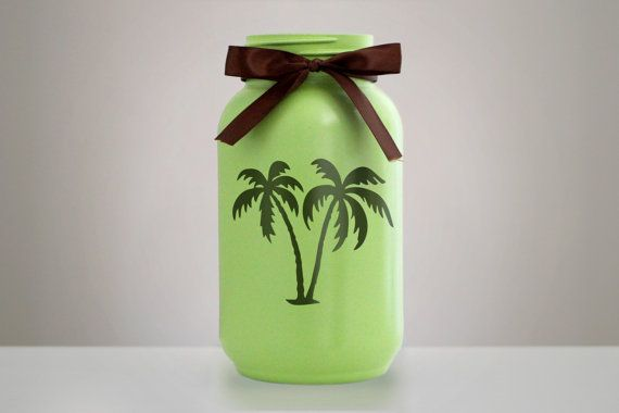 This 2 quart sized mason jar is carefully painted with an opening shaped like a palm tree which allows you to see clearly into the jar. Perfect to display with a tea light candle, summer items, candy or as is. ► NOTES • Jar is painted thoroughly on the outside only. • Twine/Ribbon is
