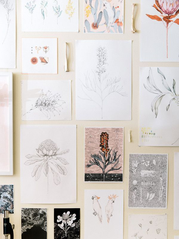 Floral illustrations by Edith Rewa liven up a wall.