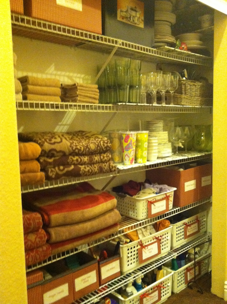 Hall closet re-do  dollar tree gift wrap and spray glue to cover boxes. printed labels and now it's all organized and easy to find