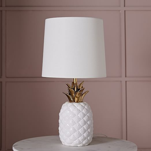 The Ceramic Nature Pineapple Table Lamp from West Elm would add a tropical punch to your kid's room! This lamp would look great on a dresser or nightstand, and the gold finish adds a nice touch.