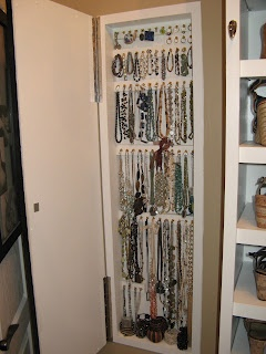 Custom Jewerly Storage Cabinet Built-In Wall.  Just add a few shelves, frame it with  decorative baseboards and buy the jewelry organizer trays that are sold at Bed Bath & Beyond.