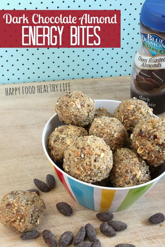 """Dark Chocolate Almond Energy Bites. These bites come together in half an hour, pack a ton of protein, and even a bit of sweet! A perfect way to grab a little energy mid-day while catering to your sweet tooth! // Happy Food Healthy Life"""