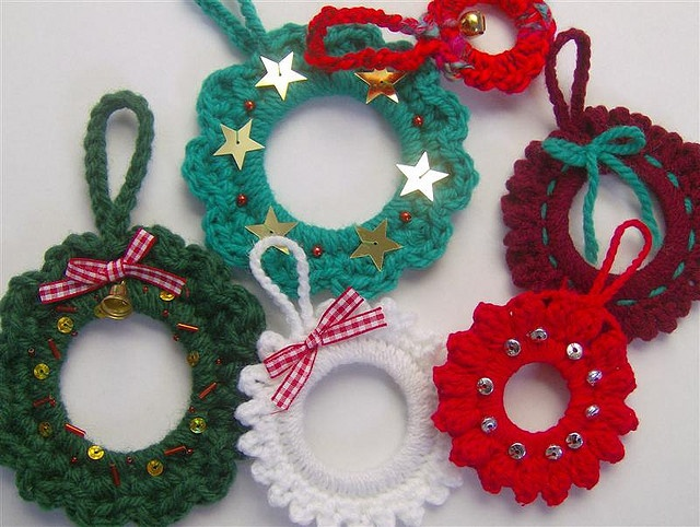 Mini crochet Christmas wreaths--my grandmother made these, i have some and they remind me of her every year when I decorate my tree!