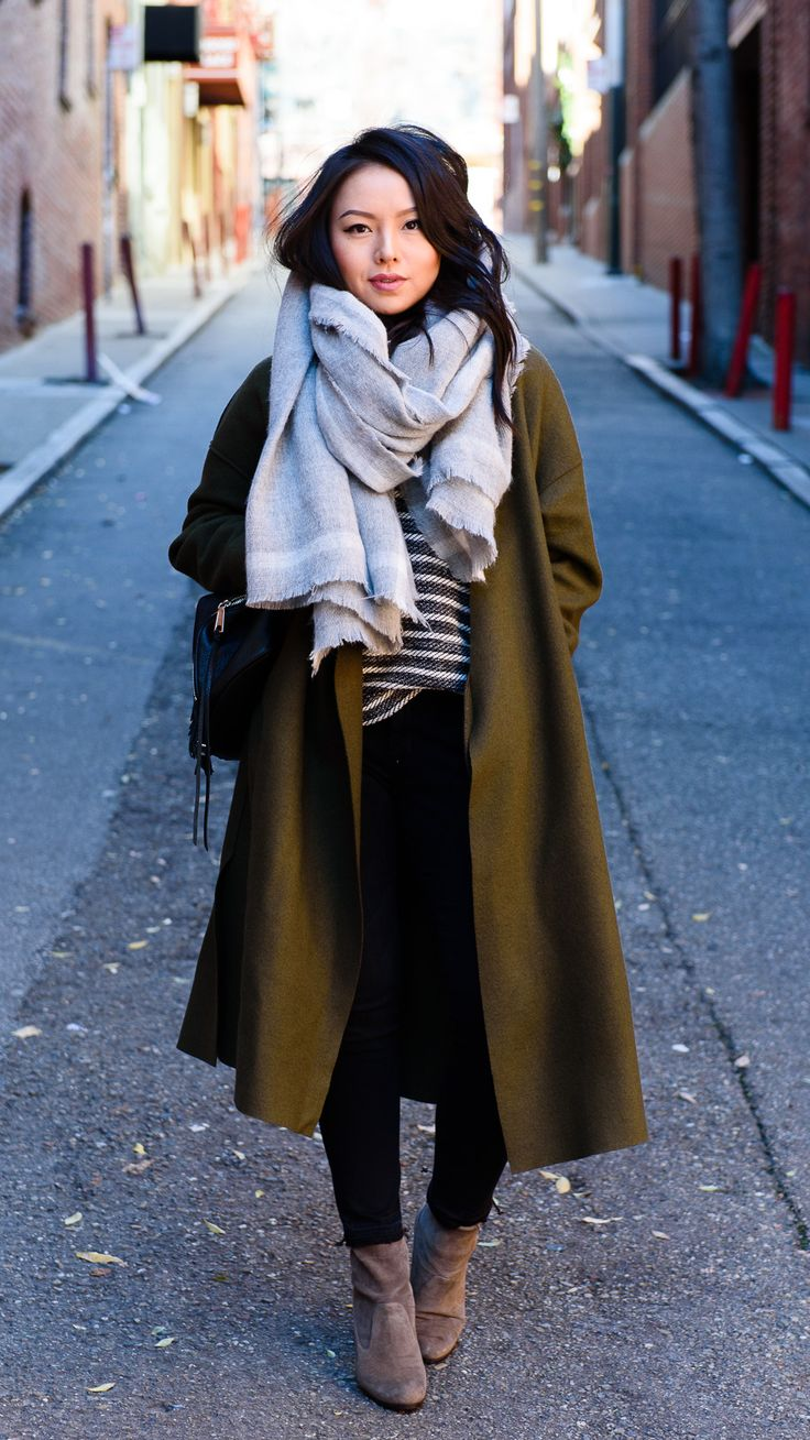 green coat, striped top, gray scarf, skinny jeans, taupe suede booties
