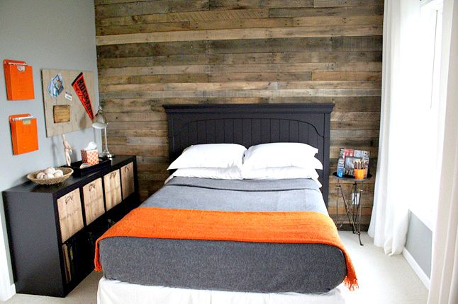 Wooden feature wall made from dozens of recycled pallets
