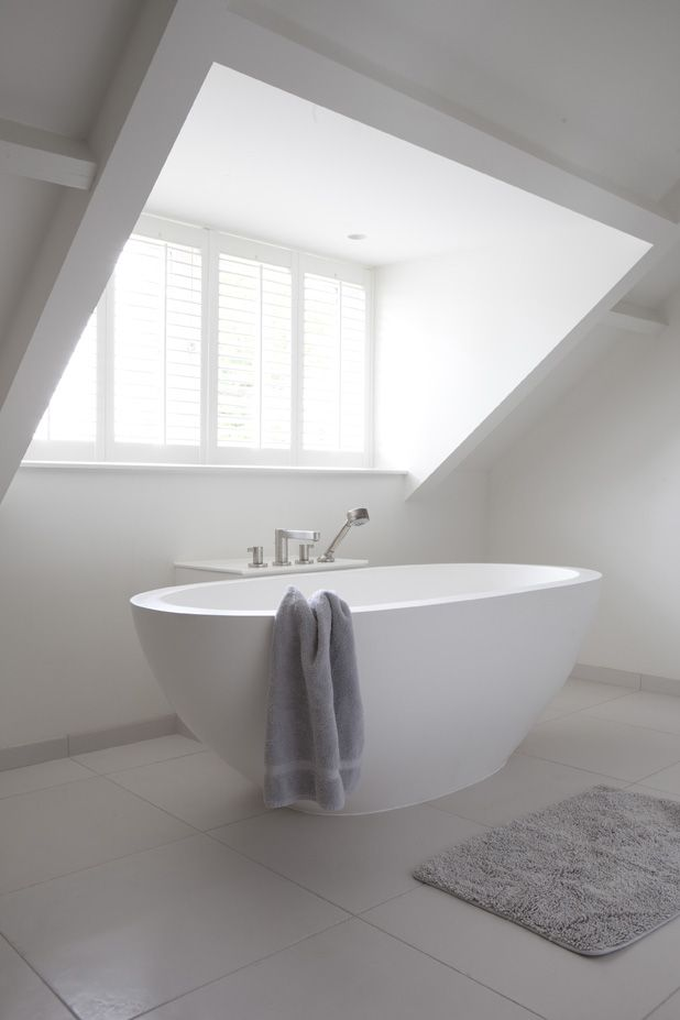 Egg tub under a sky light... perfection!  #bathroom