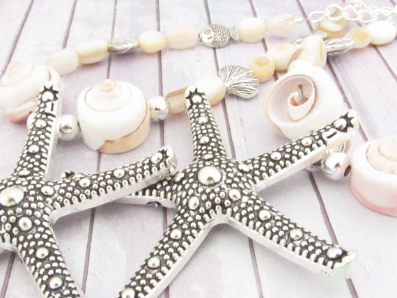 These curtain tiebacks have a silver starfish center and natural swirl sea shells. There are pretty natural shell beads and silver spacers added to enhance beach style. These drapery tiebacks add a beautiful shabby chic beach decor to your home. There is a strong shiny silver chain