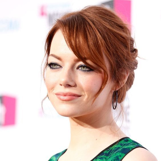 """Perfection is the goal of every bride, but sometimes imperfection makes a greater impact. """"Don't worry about every little strand,"""" says hairstylist Mara Roszak of Andy Lecompte Salon in Los Angeles, who created this look for Emma Stone."""
