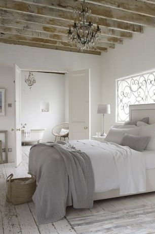 White rustic bedroom with chandelier