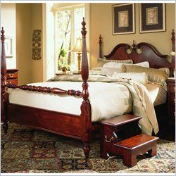 Poster Bed / In classic cherry finish, with matching bed step-up.