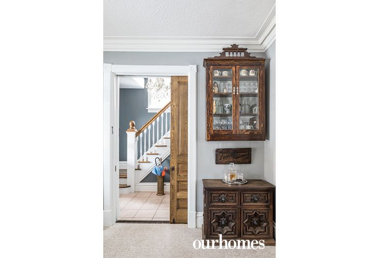 "A pocket door divides the foyer from the main living area. It's flanked by a home bar the family created themselves with reclaimed furniture pieces.    See more of this home in ""Decrepit Boarded-up Home Brought to Life in Kitchener"" from OUR HOMES Waterloo Spring 2017:  http://www.ourhomes.ca/articles/build/article/decrepit-boardedup-home-brought-to-life-in-kitchener"