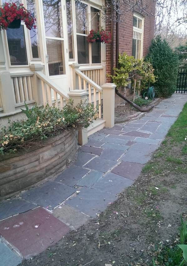 A nice flagstone walkway compliments this older home as it wrap around the side and into the back yard.