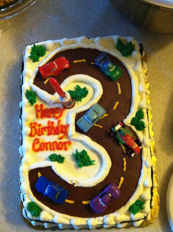 Cars birthday party cake! Cute. I have plenty of cars to put on it, too.