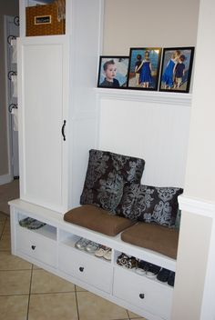 It's the hallway tree storage area I've always wanted. Maybe my hubby will see this and make it for me someday! -LM  Cheap DIY Mudroom - IKEA hack - Entirely Smitten