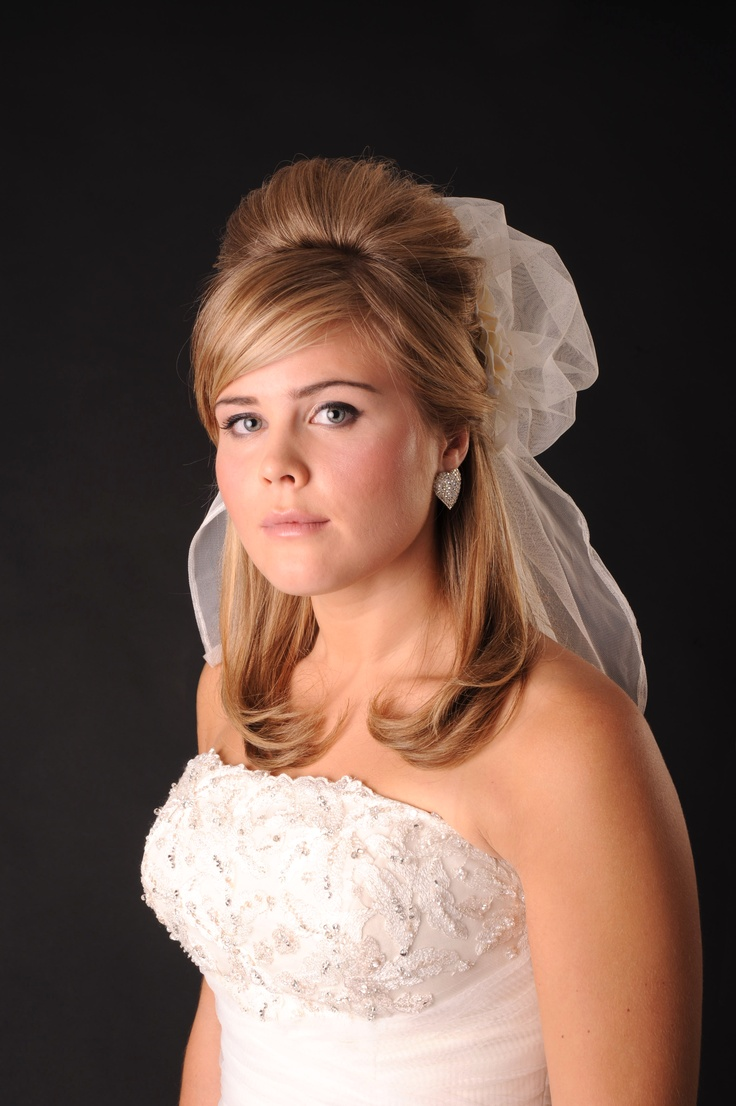 Classic bridal hairdo with veil