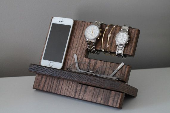 This Watch and iPhone dock is made from solid oak construction, handmade and hand-stained here in the US. Sturdy, solid, and heavy duty! There are