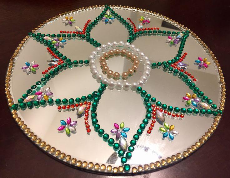 Traditional rangoli on mirror with rhinestones