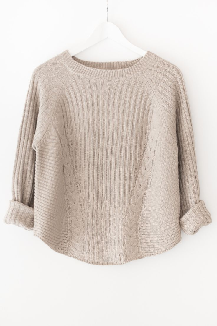 - Chunky knit sweater with ribbed and pointelle detailing - High neckline - Long sleeves - Slightly loose fit - Available in beige or dark olive - 100% Acrylic - Imported