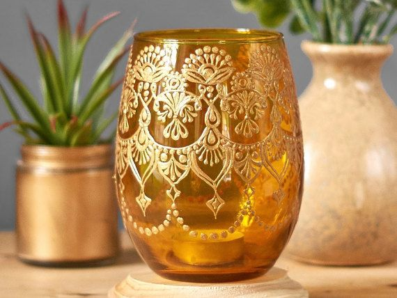 Henna Art Vase, Minimalist Decor Amber Glass Bud Vase or Candle Holder, Modern Boho Decor for Your Tabletop, Henna Centerpiece This listing is for one glass vessel, the one in the first picture , in a honey tinted apothecary glass shade that lends itself to perfectly minimalist decor and natural table decor. Both the neutral glass tint and gold mehndi henna design are hand painted, cured, and then baked on in a process that permanently sets this unique bohemian vase. This henna glass vase…