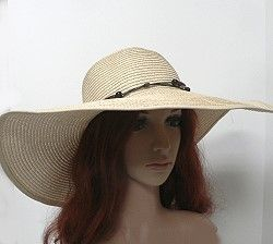 Simple, fashionable, and just enough flop—these wide brim women's hats for summer provide protection form the sun in a stylish way.  The hat has a t inch brim and simple cord band with wooden beading.  Color choices include the natural color shown.  Find more wholesale women's summer hats by clicking on the link. http://www.awnol.com/store/Hats/Casual-Hats
