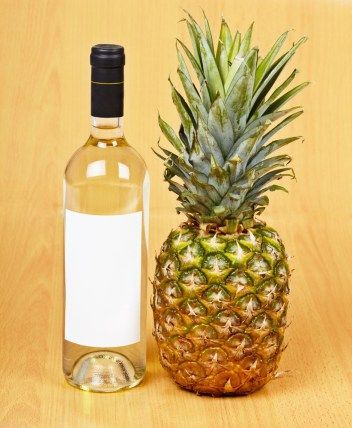 Pineapple Wine -       3 lbs. pineapple without peel and core     2 lbs. granulated sugar     1 lb. golden raisins     White wine yeast     Yeast nutrient