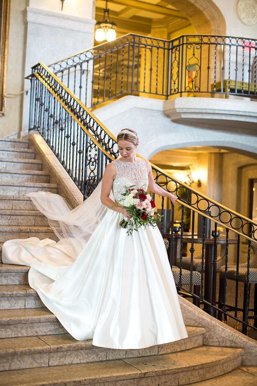 Our beautiful bride with her cascading bouquet of red and champagne roses at The Banff Springs Hotel.  Calgary Wedding Florist- Flowers by Janie www.flowersbyjanie.com  Photo: www.ericdaigle.com
