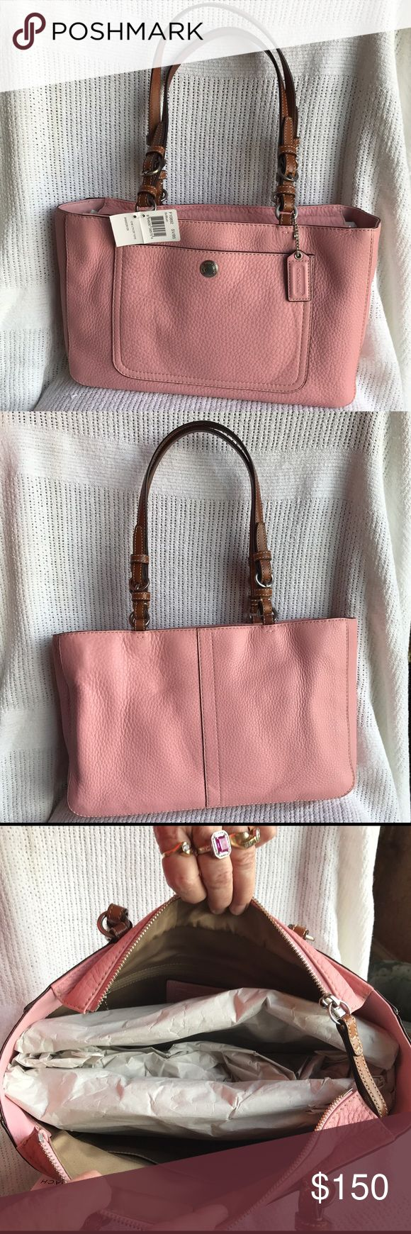 """NWT Coach pink shoulder bag NWT Coach pink shoulder bag with double handles. Open ended zip closure. Slash pocket on front. 2 slash pockets and 1 zip pocket on inside. 13"""" W x 8.25"""" T x 3.5"""" front to back. 9"""" shoulder drop. Smoke free home. No odors, tears, imperfections of any kind. Coach Bags Shoulder Bags"""