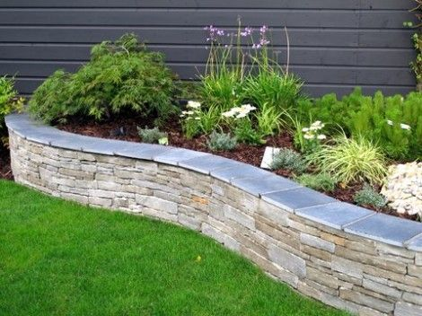 Grey Sandstone Raised Bed with Limestone Capping. Create stylish and lasting garden features with natural elements.  www.owenchubblandscapers.com we design - we build - we care. Dublin - Ireland.